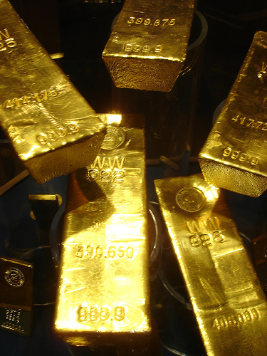 Gold surges to record high, nears $1,220