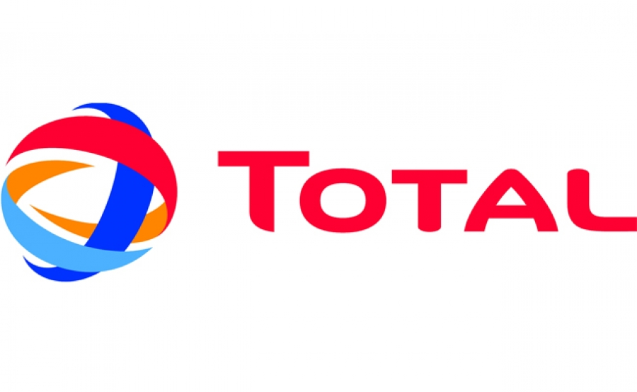Total's profit, output rise, costs go down